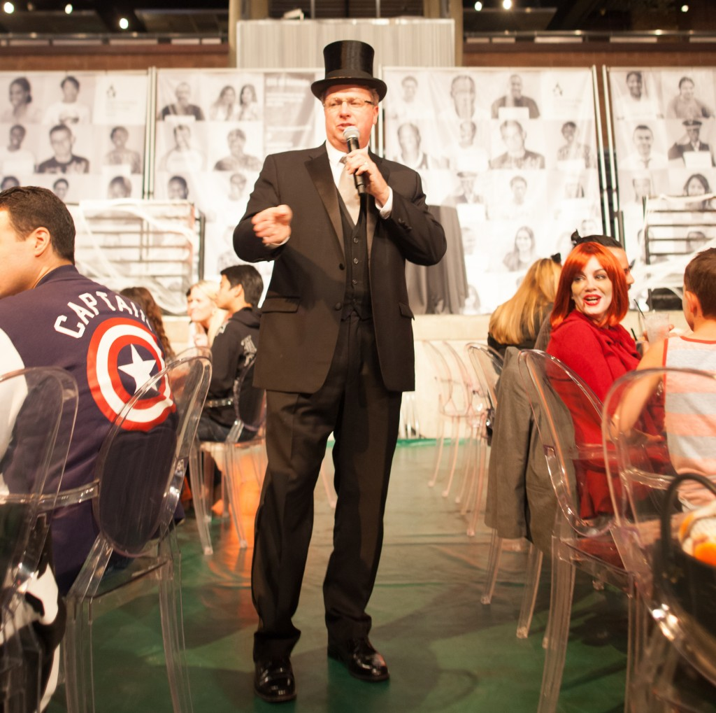 Auctioneer Christian Kolberg pumps up the room